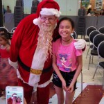 Another cute kid posing with Santa