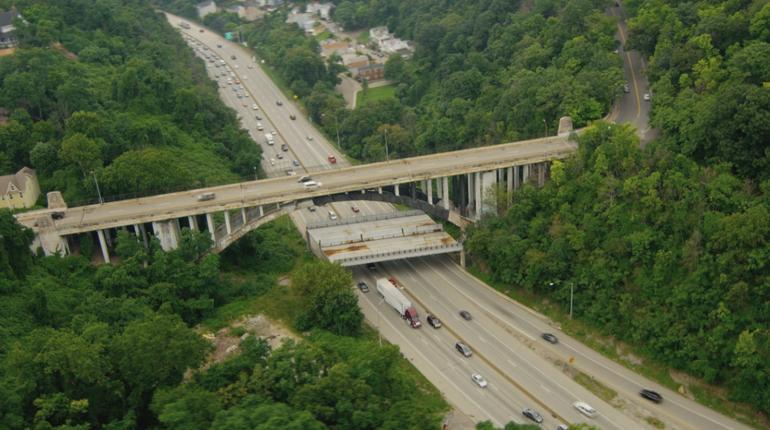 Bridge is falling apart, requiring protection below